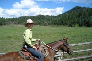 Sally Brett trail riding in Colorado